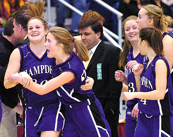 Hampden Academy's Ashley Danforth (left) and Helene Sherburne celebrate their 48-35 win over Edward Little following Friday's quarterfinal Class A game at the Augusta Civic Center on Feb. 12, 2010.   BANGOR DAILY NEWS PHOTO BY BRIDGET BROWN