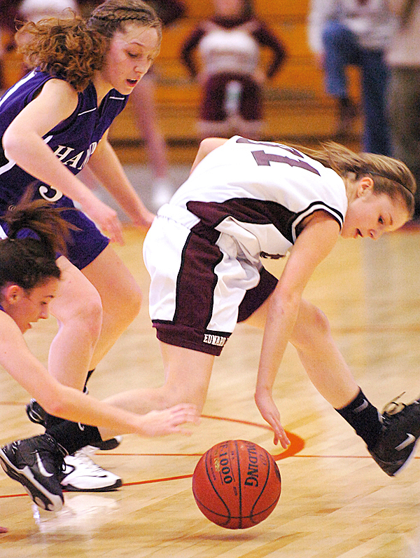 Edward Little's Ashlee Arnold (right) tries to dribble the ball ahead of Hampden Academy's Whitney Moore (upper left) and Katelynn Deraps (lower left), in the first half of Friday's quarterfinal Class A game at the Augusta Civic Center on Feb. 12, 2010. Hampden won 48-35