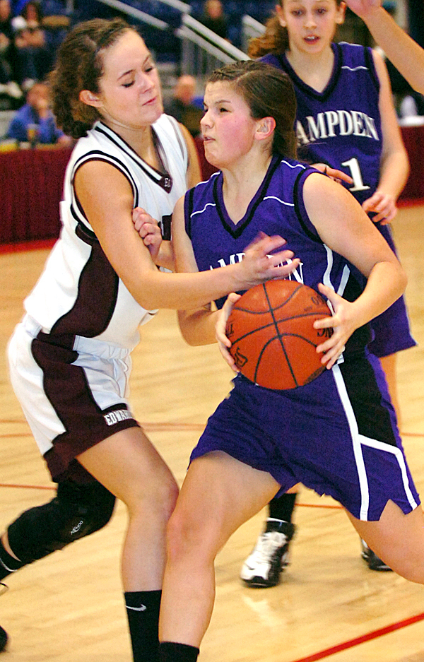 Hampden Academy's Michaela Stephenson (right) tries to break through the defense of Edward Little's Miranda Martin on her way to the basket in the first half of Friday's quarterfinal Class A game at the Augusta Civic Center on Feb. 12, 2010. BANGOR DAILY NEWS PHOTO BY BRIDGET BROWN