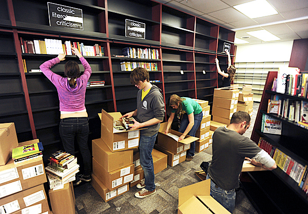 Employees of Bull Moose Music in Bangor open boxes of books and stock new fixtures with them on Wednesday, Feb. 11, 2010.   BANGOR DAILY NEWS PHOTO BY KEVIN BENNETT