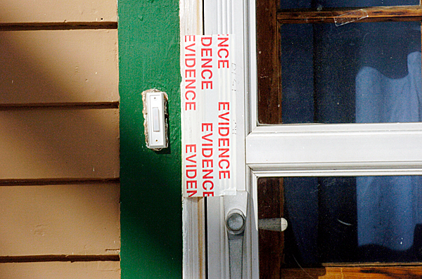 A piece of evidence tape seals a side door Wednesday of Cummings' former residence at 346 High St. in Belfast.   BANGOR DAILY NEWS FILE PHOTO BY JOHN CLARKE RUSS