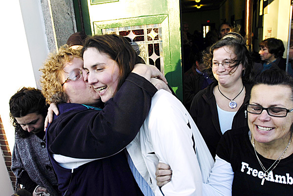 Paula Streubel (left) gives Amber Cummings a hug and a kiss as she leaves the Waldo County Courthouse in Belfast on Thursday. Clutching Cummings' arm is her coursin Chary Jopes (right). Cummings received an eight-year suspended sentence in the Dec. 8, 2008, shooting death of her husband, James Cummings, at their High Street home in Belfast.  BANGOR DAILY NEWS PHOTO BY KEVIN BENNETT