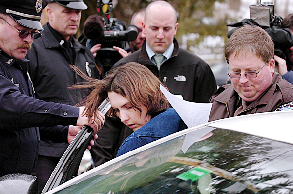 Amber Cummings (center), 31, of Belfast is escorted by Waldo County Sheriff's Department corrections officer Mike Dudley (right) and (from left) Belfast police Officers Michael Rolerson, Greg Stearns and Waldo County Sheriff's Department detective Jason Bosco, after her initial appearance in 5th District Court in Belfast on Tuesday, where she entered a plea of not guilty by reason of mental disease to the charge of murdering her husband, James Cummings. Judge Patricia Worth ordered Cummings to be held without bail pending a hearing which must be held in the next five days, according to Assistant Attorney General Leane Zainea.  BANGOR DAILY NEWS FILE PHOTO BY BRIDGET BROWN