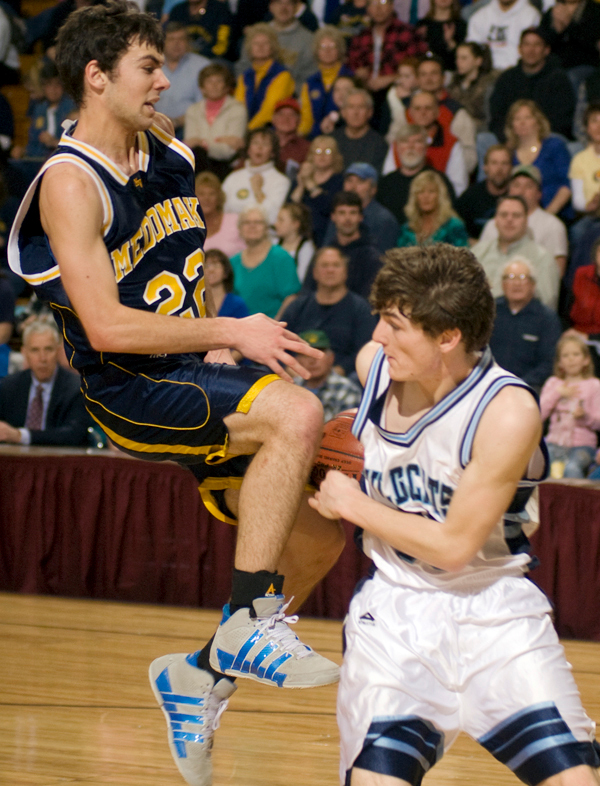 BANGOR, ME -- FEBRUARY 13, 2010 -- Presque Isle's Dillon Kingsbury fouls Medomak Valley's Alexander Mackenzie as he goes up for a shot in second half action of Saturday morning's tournament game at the Bangor Auditorium.  Medomak Valley won the game 46-42. PHOTO BY LINDA COAN O'KRESIK