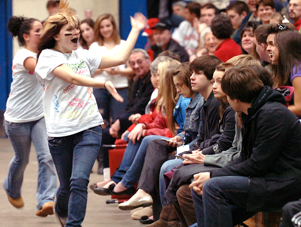 Nokomis High School seniors Rebecca Wolinski, 17, (second from left) and Nicole Pedone, 17, (left) try to rouse a somewhat uncooperative crowd into doing &quotthe wave&quot during the Warriors' game against Medomak during the Class B quarterfinal on Saturday, Feb. 13, 2010 at the Bangor Auditorium. BANGOR DAILY NEWS PHOTO BY BRIDGET BROWN
