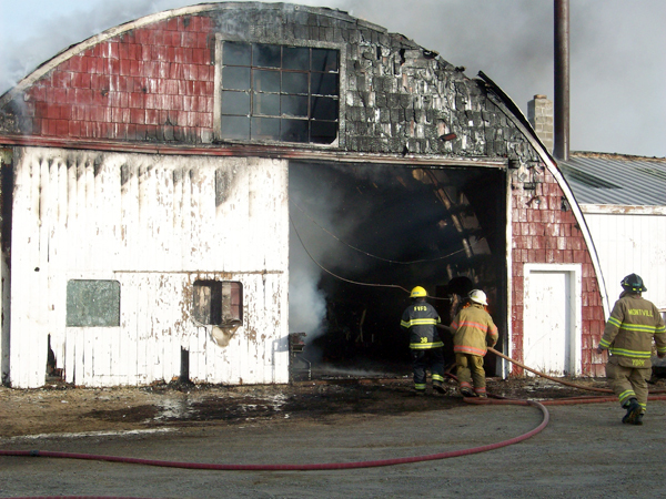 Firefighters battle a blaze off the Knox Station Road in Thorndike on Saturday, Feb. 13, 2010.     PHOTO COURTESY OF N.A. BOY