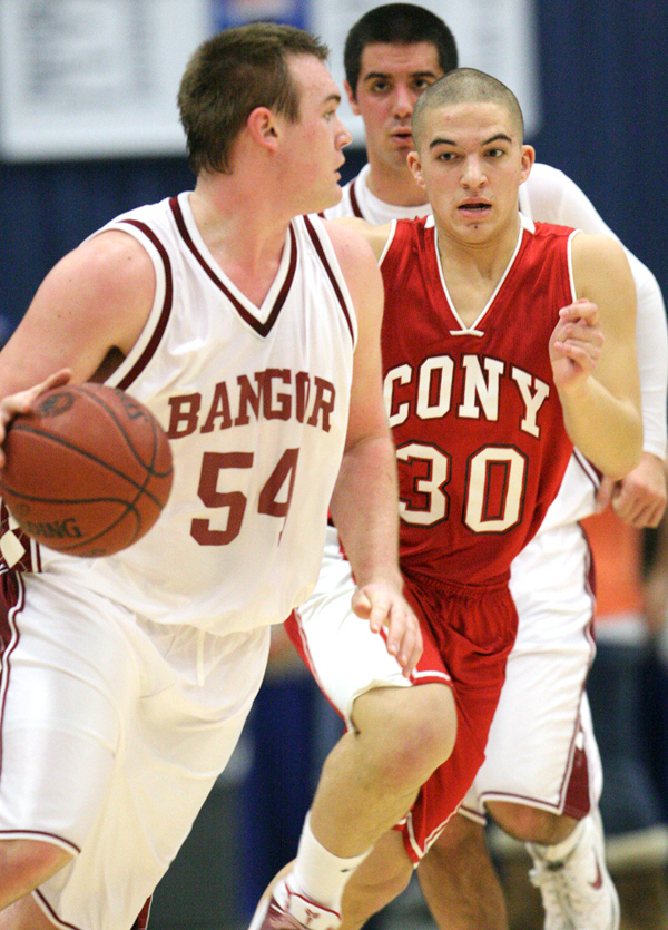 Bangor High School's forward Maxx Alexander drives past Cony High School's guard Brandon Kieltyka during their game at the Class A East Invitational Tournament at the Augusta Civic Center in Augusta, Maine Saturday.    JASON P. SMITH PHOTO