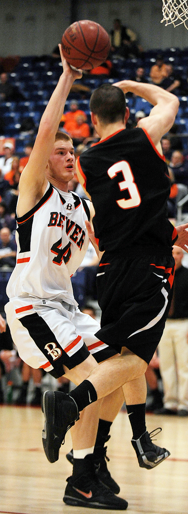 Brewer's Nate(44) Carson breaks up a pass by Skowhegan's Devin Withee (3)during Class A quarter final action on Saturday, Feb. 13, 2010 at the Augusta Civic Center. Brewer crushed Skowhegan 63-53. BANGOR DAILY NEWS PHOTO BY KEVIN BENNETT