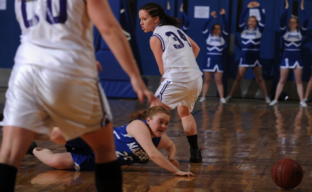 Deer Isle-Stonington's Abby Grindle (on the floor) looks to gather in a loose ball after losing it while dribbling up the flloor against Southern Aroostook's Jasmine Rockwell during Eastern Maine Class D quarter final action at the Bangor Auditorium on Monday, Feb. 15, 2010. (Bangor Daily News/Kevin Bennett)