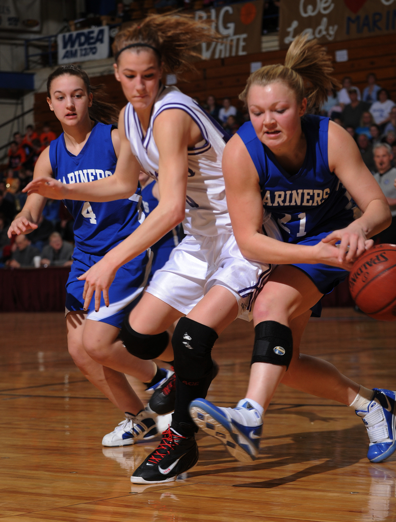 Deer Isle-Stonington's Britnie Jones, right, attempts to gain control of the ball while being closely guarded by Southern Aroostook's Evangeline Goodall, center, as Deer Isle-Stonington's Haley Brewer (4) watches during Eastern Maine Class D quarter final action at the Bangor Auditorium on Monday, Feb. 15, 2010. (Bangor Daily News/Kevin Bennett)