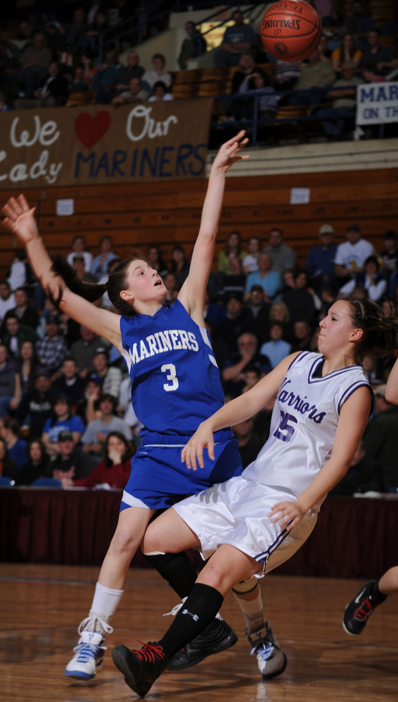 Deer Isle-Stonington's Janelle Ciomei (3) takes a shot as she fouls Southern Aroostook's Elizabeth Goodall during Eastern Maine Class D quarter final action at the Bangor Auditorium on Monday, Feb. 15, 2010. (Bangor Daily News/Kevin Bennett)