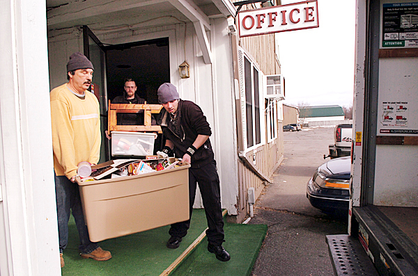 Kenny Hammons (from left), Jared Bragg and Craig Jackson move Bragg and Jackson's belongings out of the New Stable Inn in Brewer on Monday, Feb. 15, 2010, after being told that they must remove all their belongings from the hotel after a new company took ownership. The inn closed on Jan. 25 after high winds ripped off a portion of its roof. Both Bragg and Jackson lived at the hotel for more than two years and, while Jackson has found another place to live, Bragg is still trying to find a suitable residence.  BANGOR DAILY NEWS PHOTO BY BRIDGET BROWN