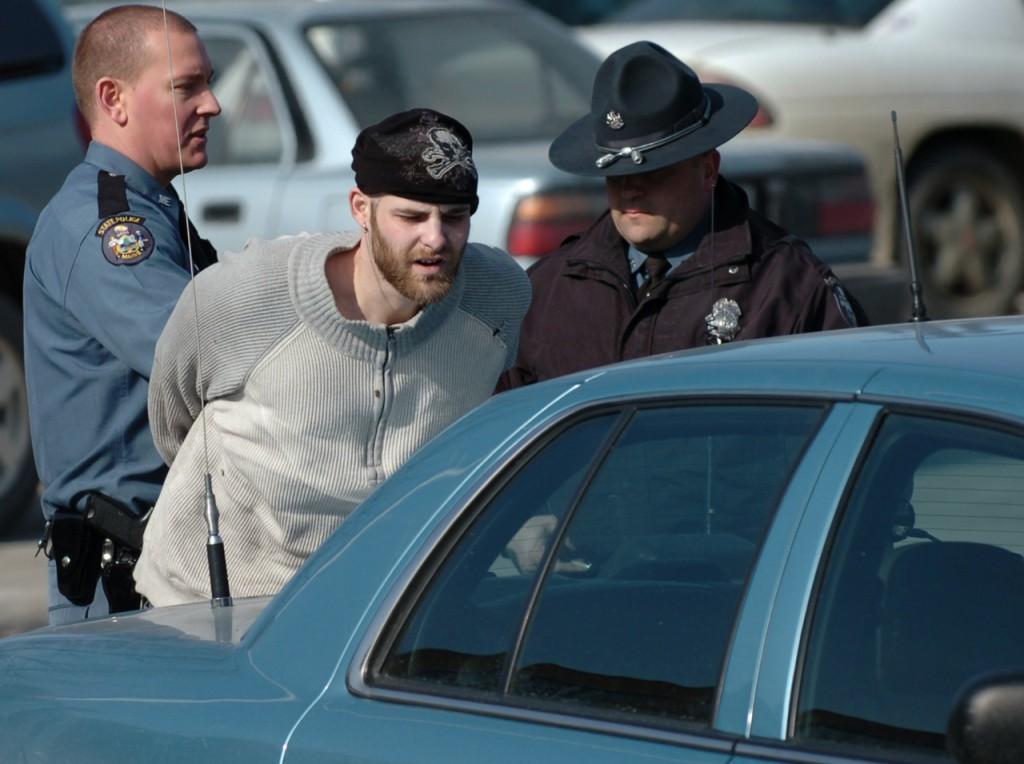 (BANGOR DAILY NEWS PHOTO BY BRIDGET BROWN)  CAPTION  Maine State Police members including Sgt. Sean Hashey (right) arrest Christopher Norris, 28, of Bangor on Tuesday morning, Feb. 16, 2010 near St. Joseph Hospital in Bangor. According to Hashey, Norris was riding as a passenger in a car when the driver was stopped for a motor vehicle violation and Norris fled from the vehicle. Norris was arrested for outstanding warrants and will likely be charged with criminal threatening according to Hashey because &quothe claimed that he had a firearm and that he would shoot.&quot (Bangor Daily News/Bridget Brown)