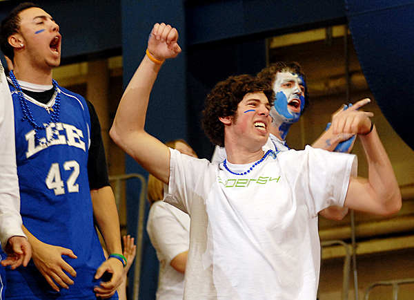 Lee Academy fans David Hanson, Michael Suffield and Ruth Struth (left to right) cheer on their team in the quarterfinal game against Penquis Valley High School on Tuesday morning.  Lee won the game 50-42. BANGOR DAILY NEWS PHOTO BY LINDA COAN O'KRESIK