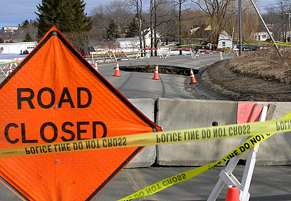 A sinkhole shut down parts of Old County Road in Rockland Tuesday, Feb. 16, 2010. The hole started as a pothole late Monday afternoon. By Tuesday afternoon the hole ate up half of the road and burrowed down through a tunnel below. BANGOR DAILY NEWS PHOTO BY HEATHER STEEVES