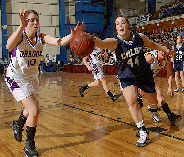 Calais' Nicole Osborne, (44), gets her hand on the loose ball ahead of Woodland's Ariel Knights, (10), in the second half of their game at the Bangor Auditorium, Tuesday, Feb. 16, 2010. BANGOR DAILY NEWS PHOTO BY MICHAEL C. YORK