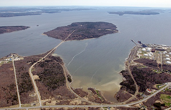 A causeway bends to the right, connecting the mainland to 941-acre Sears Island in Searsport on Penobscot Bay. Mack Point with its oil and gasoline tank farm is visible to the right, and U.S. Route 1 is visible at the bottom of the photo. On the left is the GAC plant, where chemicals used in the paper industry are made. A former owner of Sears Island described ?the goodness of the harbor? and ?the beautiful formation of the island,? and each has been a rallying cry for those who would commercially develop Sears Island and those who want to preserve it.    BANGOR DAILY NEWS FILE PHOTO BY GABOR DEGRE