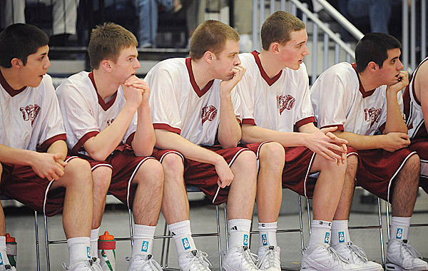 Bangor players watch the game as they play Edward Little four minute overtime of the Class A semifinal game in Augusta Wednesday.  bangor lost in overtime 60-57BANGOR DAILY NEWS PHOTO BY GABOR DEGRE