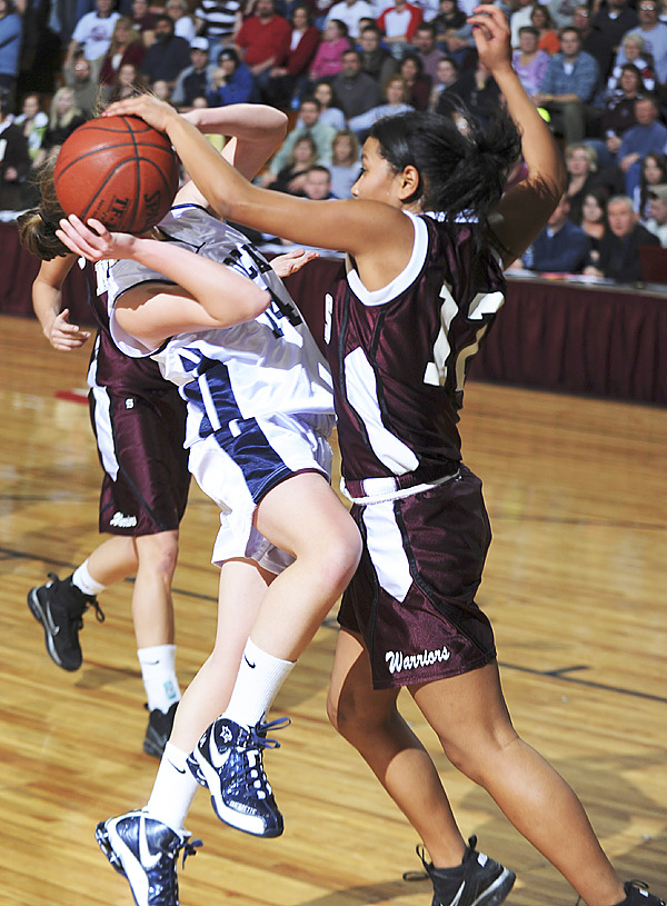 Nokomis's Julie Smith, right, fouls Presque Isle's Chandler Guerrette, left, during 2nd period action  on Wednesday, Feb. 17, 2010 during Class B semi final action at the Bangor Auditorium. (Bangor Daily News/Kevin Bennett)