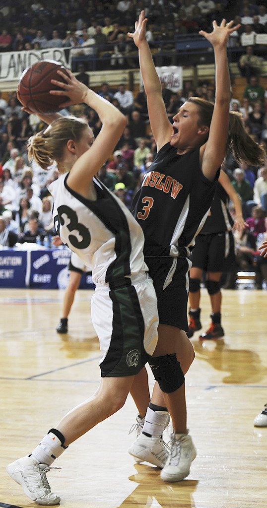 MDI's Mackenzie Curtis, left,  runs into Winslow's Kaylee Constable, right, on Wednesday, Feb. 17, 2010 during Class B semi final action at the Bangor Auditorium. (Bangor Daily News/Kevin Bennett) (Bangor Daily News/Kevin Bennett)
