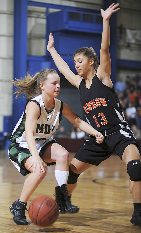 MDI's Sara Carroll, left, brings the ball to the hoop against Winslow's Alliyah Veillleux during 1st perod action on Wednesday, Feb. 17, 2010 during Class B semi final action at the Bangor Auditorium. (Bangor Daily News/Kevin Bennett)