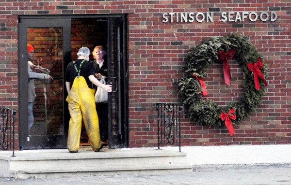 After taking a break late Thursday afternoon, an employee rejoins co-workers inside the former Stinson Seafood Plant . On Wednesday, workers there were notified by plant owner Bumble Bee Food that the sardine cannery will be closed in April after being a fixture there for more than 100 years.  BANGOR DAILY NEWS PHOTO BY JOHN CLARKE RUSS
