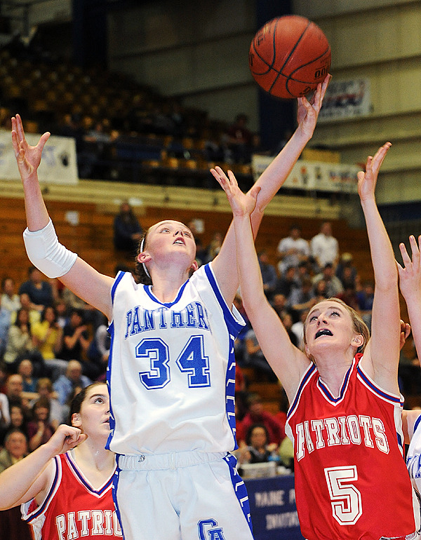 Central Aroostook's Victoria McIntyre (left) takes a rebound over Bangor Christian's  Katherine Bragg during the firs half of the Class D Tournament semifinal game in Bangor Thursday evening. (Bangor Daily News/Gabor Degre)