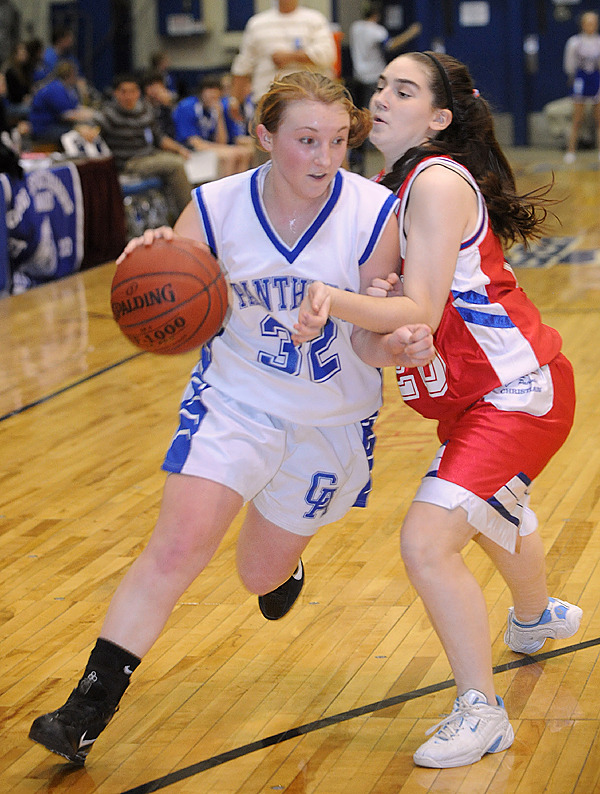 Central Aroostook's Rachel Grew (left) drives up the court past Bangor Christian's Kristen Roemmich during the firs half of the Class D Tournament semifinal game in Bangor Thursday evening. (Bangor Daily News/Gabor Degre)