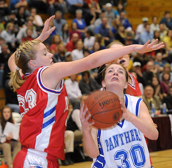 Bangor Christian's Meredith Bean (left) tries to block a shot by Central Aroostook's Kristen Long drives up the court past h during the firs half of the Class D Tournament semifinal game in Bangor Thursday evening. (Bangor Daily News/Gabor Degre)