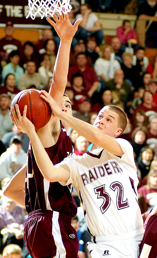 BANGOR, ME -- FEBRUARY 19, 2010 -- Washington Raiders Samuel Stevens goes up for a shot around Foxcroft defender James Johnson in the first half of Thursday's Class C semi final game at the Bangor Auditorium.  BANGOR DAILY NEWS PHOTO BY LINDA COAN O'KRESIK