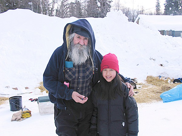 Lily Cousins and Alaskan musher Charlie Boulding. In 2005, Brooksville students traveled to Alaska to view the famous Iditarod sled dog race. Fundraisers will be held during the next year to support a similar trip by Brooksville students to Alaska in 2011.   PHOTO COURTESY OF NADA LEPER