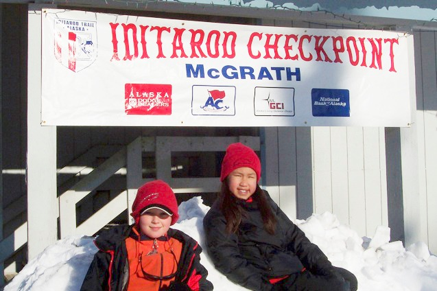 Schuyler Van der Eb (left) and Lily Cousins (right) pictured at an Iditarod checkpoint in McGrath, Alaska. McGrath hosts one of twenty-six checkpoints that mushers, or dog sled racers, must pass through with their dog teams en route to completing the famous Iditarod Trail which passes over 1,000 miles of Alaskan wilderness. PHOTO COURTESY OF NADA LEPER