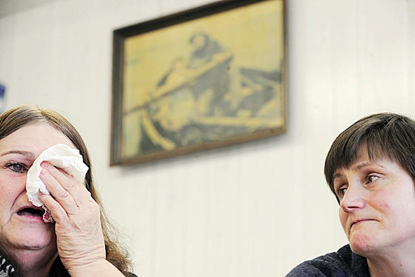 A grieving Florence Lank, left, talks about losing her husband, the late Loren Lank, as her neighbor Shelley Tinker, right, lends a sympathetic ear during a recent meeting with the BDN in downtown Lubec. Loren Lank and his sternman, Logan Preston, 19, drowned in March 2009 when their fishing vessel, All American, went down in Cobscook Bay. Tinker's husband, Steven &quotTeea&quot Tinker is a fifth generation commercial fisherman. Photographed January 11, 2010. BANGOR DAILY NEWS PHOTO BY JOHN CLARKE RUSS