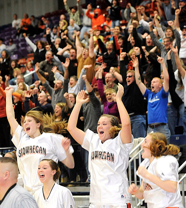Skowhegan's players and fans celebrate as Liz Noddin scored with less then 5 seconds left on the clock earning Skowhegan the 38-36 victory ober Brunswick in the Eastern Maine Chamionship at the Augusta Civic Center Friday.   BANGOR DAILY NEWS PHOTO BY GABOR DEGRE
