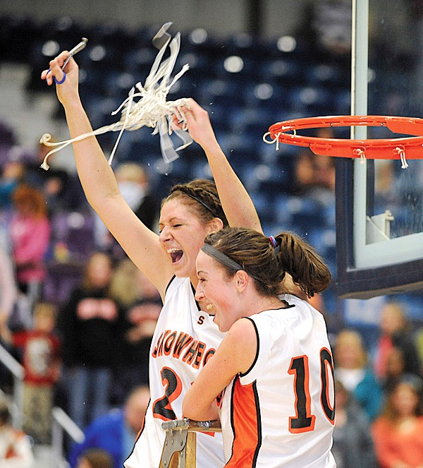 Skowhegan's Liz Noddin (right) and Mackenzie Smith clebrate the team's Eastern Maine Chamionship victory over Brunswick at the Augusta Civic Center Friday.  Noddin scored with less then 5 seconds left on the clock earning Skowhegan the 38-36 victory.  (BANGOR DAILY NEWS PHOTO BY GABOR DEGRE
