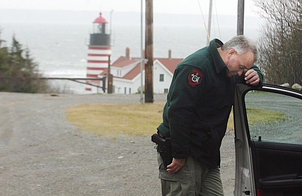 Officer Russell Wright of the Maine Marine Patrol pauses Thursday morning during the search for a missing periwinkle harvester near Quoddy Head State Park. Kristopher Fergerson of Lubec was reported missing Tuesday evening.  BANGOR DAILY NEWS FILE PHOTO BY KATE COLLINS
