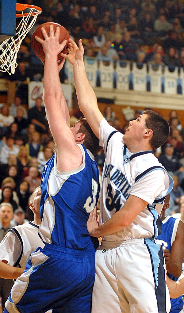 BANGOR, ME -- FEBRUARY 19, 2010 -- Calaises Dylan Ramsdell atempts to block a shot by Lee's Ryan Beers in first half action of Friday's Class C semi final game.  Calais won the game 57-47.  BANGOR DAILY NEWS PHOTO BY LINDA COAN O'KRESIK