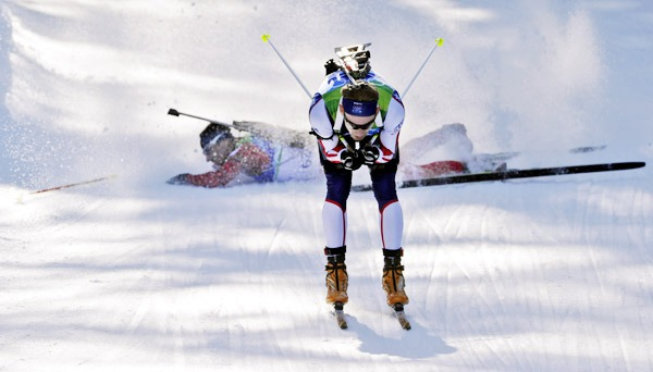 Latvia's Kristaps Libietis, behind, crashes while skating behind Lowell Bailey of the United States during the men's biathlon 20 km individual race at the Vancouver 2010 Olympics in Whistler, British Columbia, Thursday, Feb. 18, 2010. AP PHOTO BY JENS MEYER