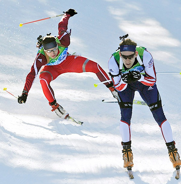 Latvia's Kristaps Libietis, left, crashes while skating behind Lowell Bailey of the United States during the men's biathlon 20 km individual race at the Vancouver 2010 Olympics in Whistler, British Columbia, Thursday, Feb. 18, 2010. AP PHOTO BY JENS MEYER