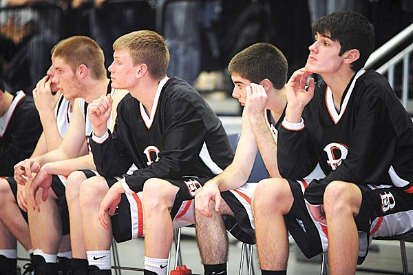 Brewer's players on the bench sit dejected as the chance of victory slips away in the last few seconds of the game against Edward Little during the Eastern Maine Championship Game in Augusta Friday.  BANGOR DAILY NEWS PHOTO BY GABOR DEGRE