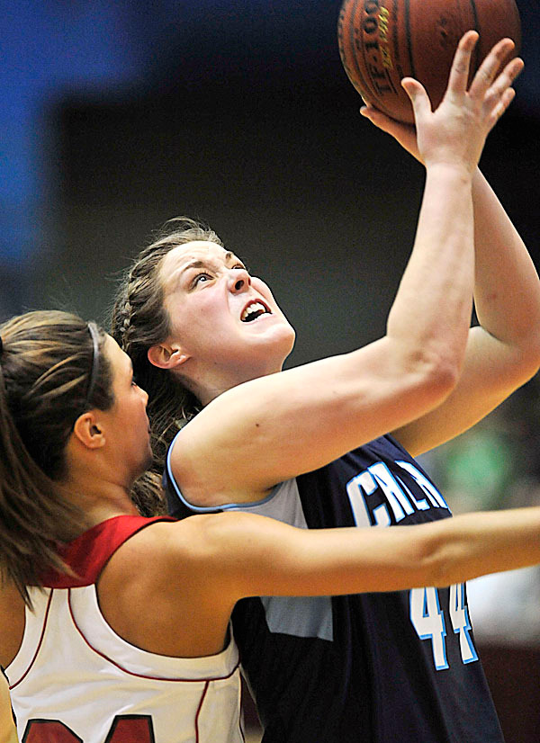 Calais' Nicole Osborne, (44), drives to the hoop past the defense of Central's Jocelyn Portman ,(34), , In the second half of their game at the auditorium Friday, Feb. 19,2010.  BANGOR DAILY NEWS PHOTO BY MICHAEL C. YORK