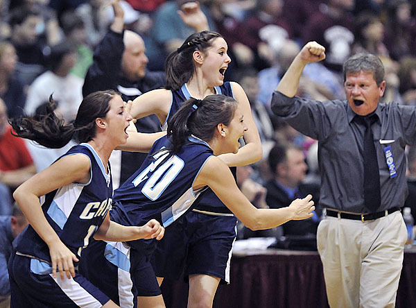 Calais Girl's basketball coach Dana Redding celebrates as his team rushes the floor in triumph over Washington Academy in the Class C Eastern Maine final game at the Bangor Auditorium, Saturday, Feb. 20, 2010. BANGOR DAILY NEWS PHOTO BY MICHAEL C. YORK