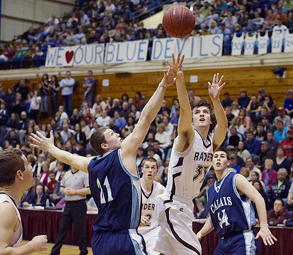 Washington Academy's Bryce Colbeth, (33), puts up a shot over Calais' Cameron Shorey, (21), in the first half of their game in Bangor, Saturday, Feb. 20, 2010. BANGOR DAILY NEWS PHOTO BY MICHAEL C. YORK