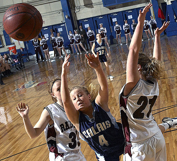 Calais' Alexandria McVicar, (4), loses the ball while being double-teamed by Washington Academy's Stefani Jones, (35), and Andi Flannery, (21), in the first half of their game at the Bangor Auditorium, Saturday, Feb. 20, 2010. BANGOR DAILY NEWS PHOTO BY MICHAEL C. YORK