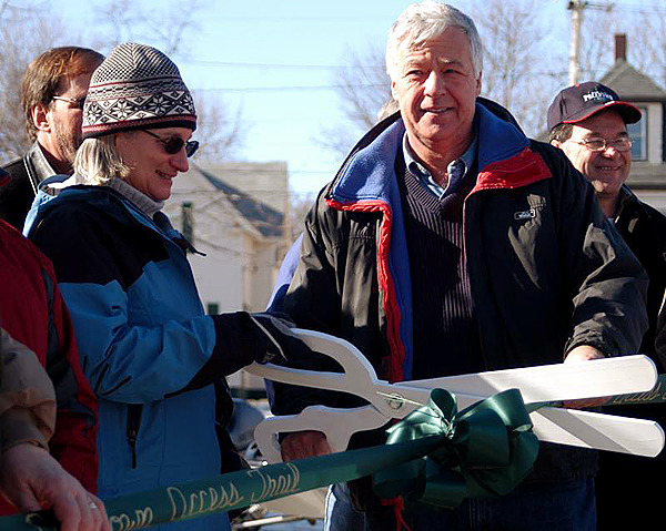Katahdin Forest Management President Marcia McKeague and U.S. Rep. Michael Michaud cut a ribbon opening a snowmobile and multi-use recreational trail on Penobscot Avenue in Millinocket on Saturday. BANGOR DAILY NEWS PHOTO BY NICK SAMBIDES JR.