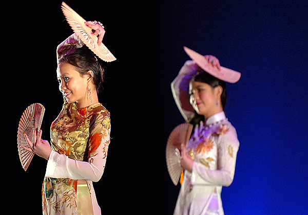 University of Maine freshman Chi Truong (left) and sophomore Dung Tran perform a fan dance during the school's sixth annual International Dance Festival on Saturday, Feb. 20, 2010 at the Collins Center in Orono. The event featured about 100 dancers representing dozens of countries and cultures from around the world. BANGOR DAILY NEWS PHOTO BY BRIDGET BROWN