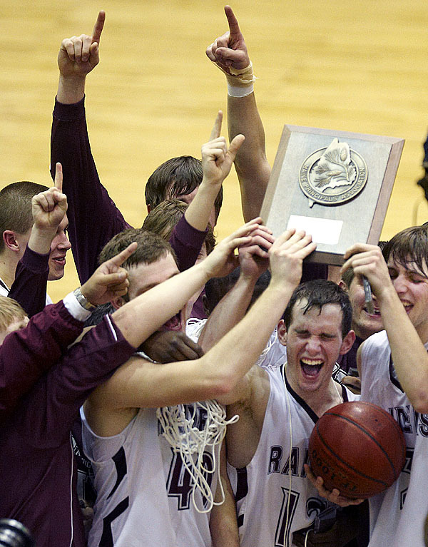 The Washington Academy boys celebrate their championship win over Calais, Saturday, Feb. 20, 2010. BANGOR DAILY NEWS PHOTO BY MICHAEL C. YORK