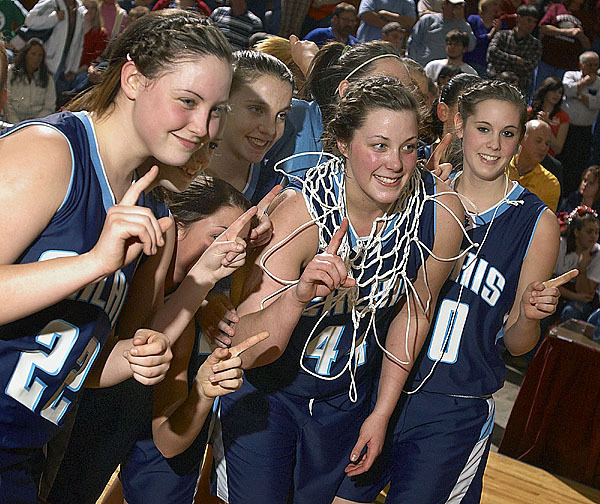 Calais Girls team members celebrate their victory over Washington Academy on Saturday, Feb. 20, 2010. BANGOR DAILY NEWS PHOTO BY MICHAEL C. YORK