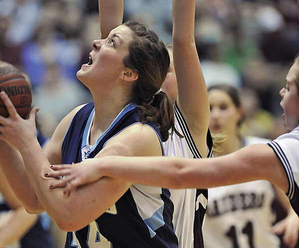 Calais' Nicole Osborne, (44), gets fouled by Washington Academy's Andi Flannery in the second half of their game at the Bangor Auditorium, Saturday Feb. 20, 2010. BANGOR DAILY NEWS PHOTO BY MICHAEL C. YORK