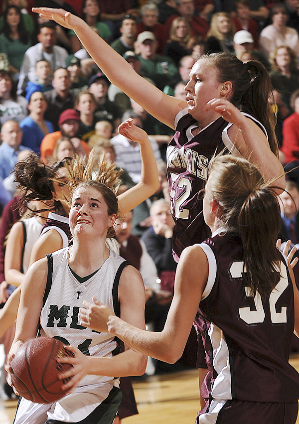 MDI's Megan Phelps, left, shoots under pressure from Nokomis's Danielle Watson, center and Kara Batchelder, right, on Saturday, Feb. 20, 2010 during the Class B Eastern Maine Regional Final at the Bangor Auditorium. Nokomis won 37-22. BANGOR DAILY NEWS PHOTO BY KEVIN BENNETT